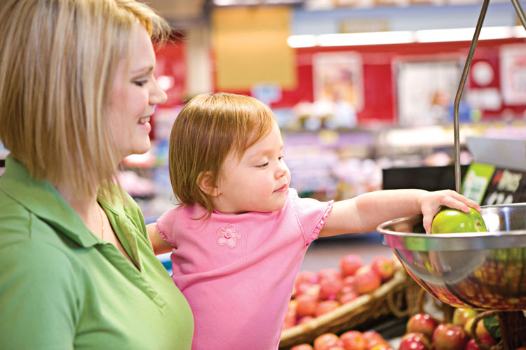 mother and daughter at grocery store
